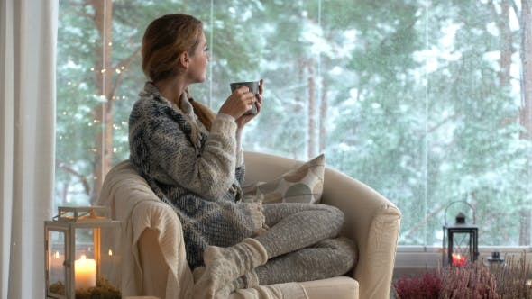 Thumbnail for Young Happy Woman Drinking Cup of Coffee Wearing Knitted Sweater