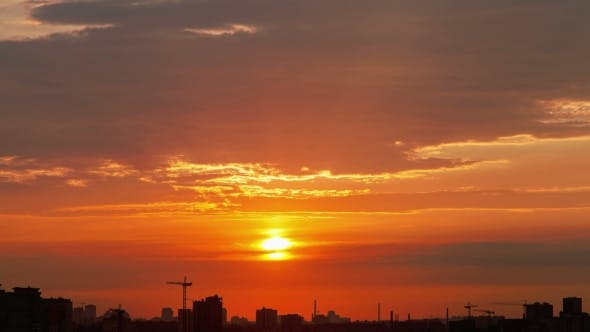 Thumbnail for Sunset Over the Silhouettes of Buildings in the City
