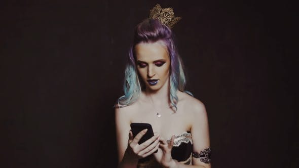 Cover Image for Young Beautiful Woman with Smart Phone