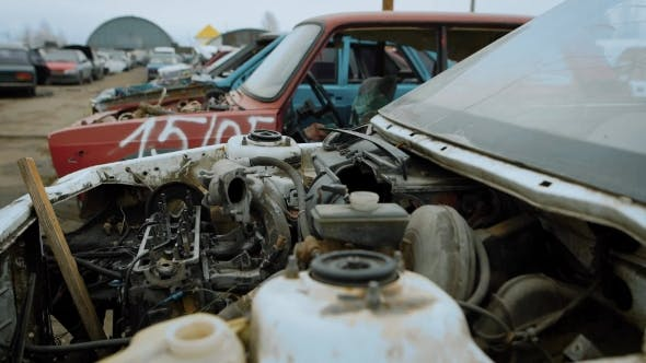 Row of Wrecked Car on Huge Junkyard