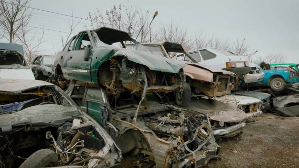 Thumbnail for Stacked Wrecked Cars on Grungy Junkyard