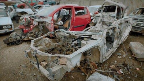 Destroyed Rusty Car on Junkyard