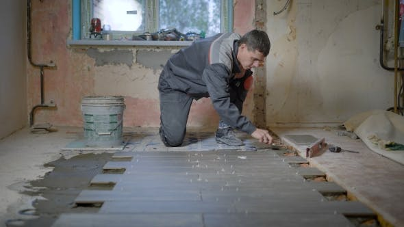 Thumbnail for The Worker in the Building Form Checks the Level of the Surface on the Ceramic Tile