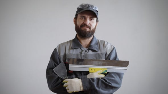 Thumbnail for a Portrait of an Adult and a Bearded Man Who Is Dressed in a Construction Uniform