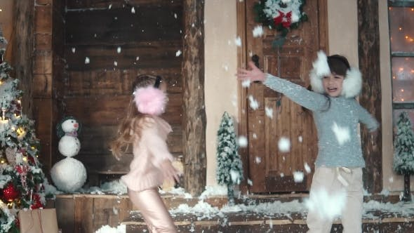 Thumbnail for Christmas or New Year. Happy Children Throw Up Snow. the Children Enjoy the Christmas Holidays