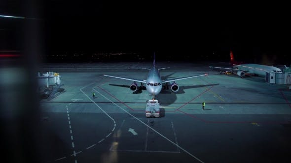Thumbnail for Illuminated Aerodrome in Night Time with Planes Prepared for Leaving