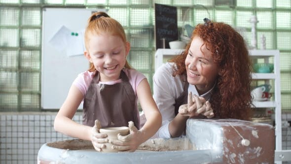 Thumbnail for On Girder Circle Teacher Helps Student To Make a Pitcher of Clay.