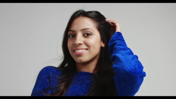 Thumbnail for Attractive Latino Female Model in Warm Bright Blue Sweater