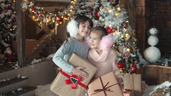 Thumbnail for Portrait of Two Little Girls Holding Beautifully Packaged Gifts