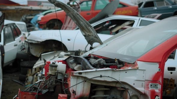 Thumbnail for Shot of Broken and Torn Apart Cars Lying on Junkyard for Recycling.