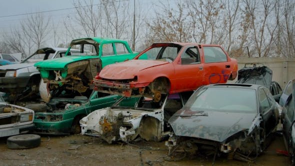 Thumbnail for Piles of Old Broken Rusty Cars on Wrecking Yard
