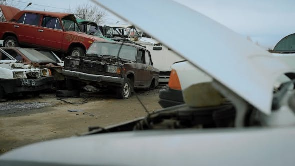 Thumbnail for Close Look at the Wrecked Cars on Scrapyard Under the Sky.