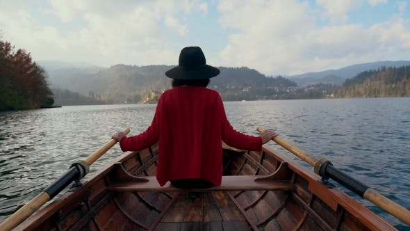 Thumbnail for A Hipster Woman Traveling By Boat in a Lake
