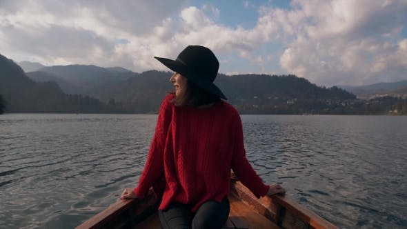 Thumbnail for A Woman Traveling By Boat in a Lake at Sunset