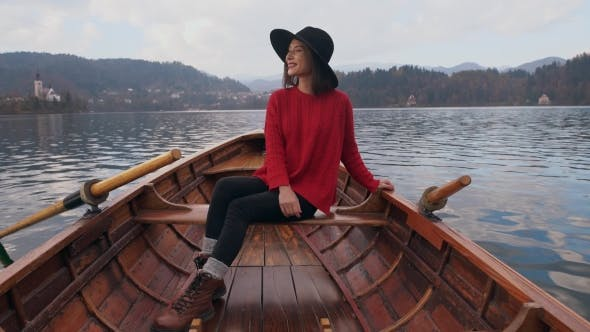 Thumbnail for Happy Woman Enjoying Nature in a Wooden Boat