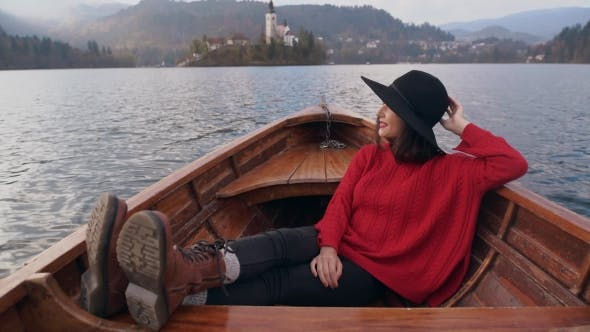 Thumbnail for Young Woman Sitting in a Wooden Boat