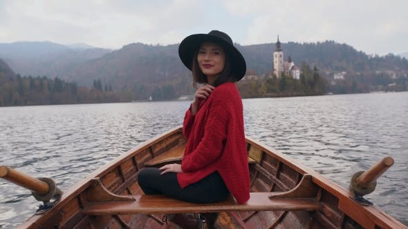 Thumbnail for Young Woman Enjoying Nature in a Wooden Boat