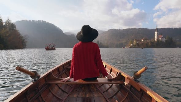 Thumbnail for Young Woman Sitting Back in a Wooden Boat