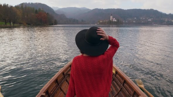 Thumbnail for Young Lady Enjoying Nature in a Wooden Boat