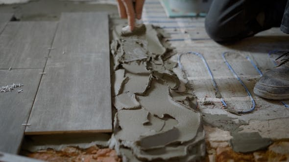 Thumbnail for Anonymous Man Applying Cement on Floor While Working on Site