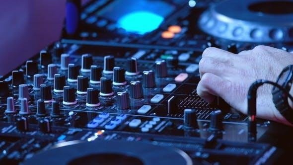 DJ Plays Mix on Controller at a Disco
