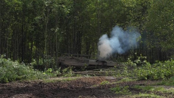 Army Tank Destroy Green Forest To Build Road in Forest on Shooting Range