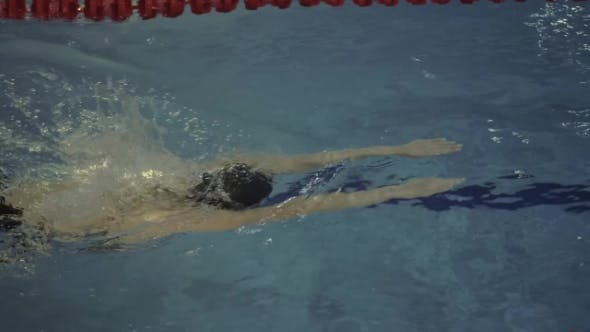 Thumbnail for Woman Swimmer in Goggles Floating Breaststroke in Water Swimming Pool