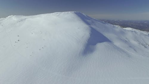 Snow Mountain with Traces of Descents