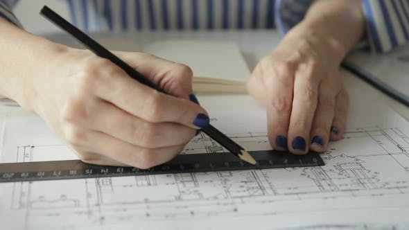 Thumbnail for Female Employee Draws Plan with Ruler and Pencil Sitting in Office