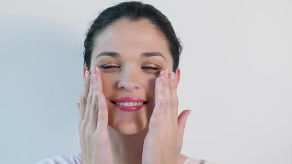 Thumbnail for Young Woman Applying Face Cream