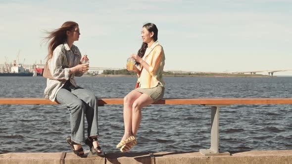 Girlfriends Chatting at Waterfront