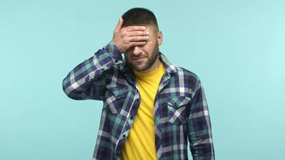 Slow Motion of Frustrated Adult Man Facepalm Slap Forehead and Looking Down with Gloomy and Upset