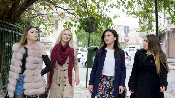 Thumbnail for Group of Happy Girl Friends Walking in the Old Part of an City