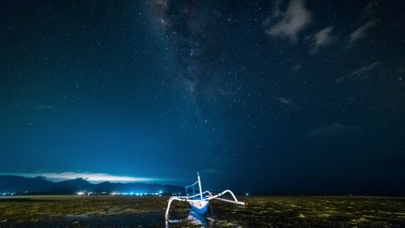 Cover Image for The Fishing Boat Is Aground Against the Background of the Milky Way
