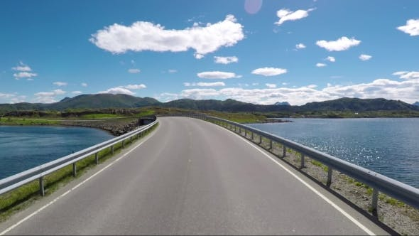 Cover Image for Driving a Car on a Road in Norway Atlantic Ocean Road