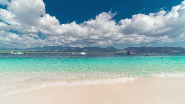 Cover Image for Tropical Island and Azure Beach with Sky and Clouds on Gili Island, Indonesia