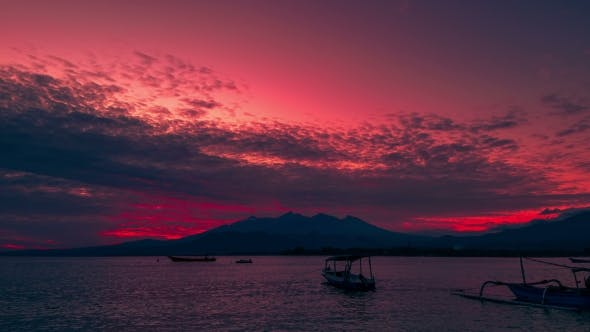 Cover Image for Sunrise with Boat in Ocean Near Gili Island on Background Rinjani Volcano in Lombok Island