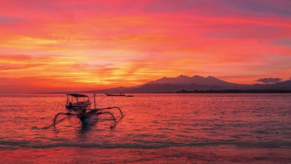 Cover Image for Sunrise Above Volcano Rinjani with Fishing Boat, Lombok Island in Indonesia