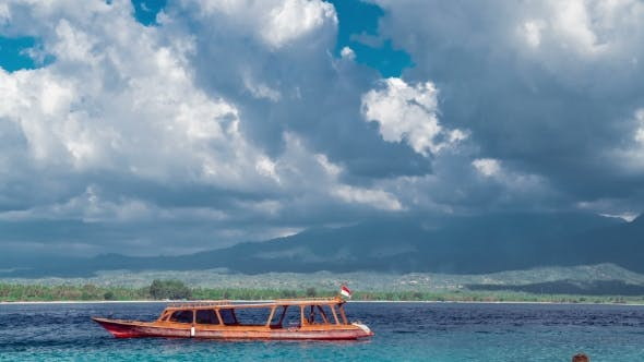 Cover Image for Boats Parking on the Azure Sea on Background Lombok Island with Sky and Clouds, Indonesia