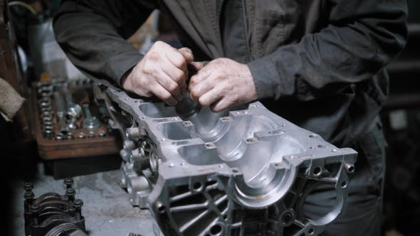 Thumbnail for Professional Mechanic Disassembling Engine Block in Car Maintenance Centre.