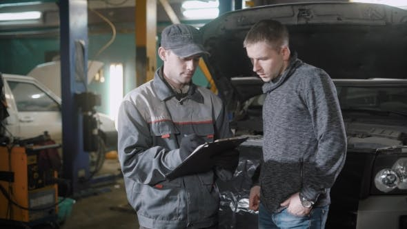 Thumbnail for Mechanic and a Man Discussing the Cost of Car Service