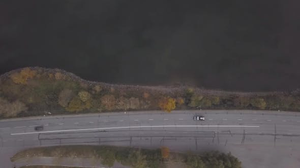 Top View Trucks and Cars Moving on Highway Road on River Background