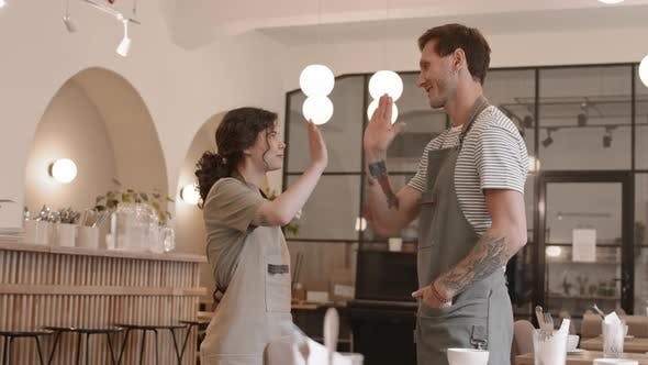 Thumbnail for Female and Male Waiters High-Fiving