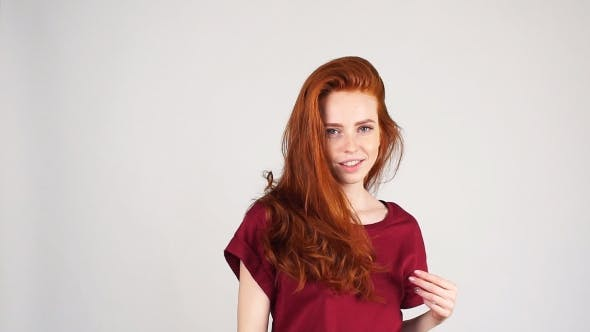 Thumbnail for Fashional Portrait of Redhead Model on White Background. Perfect Girl Is Posing in Studio.