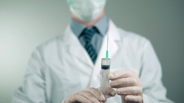Thumbnail for , Syringe with Medicine in the Hands of the Doctor. Health Care.