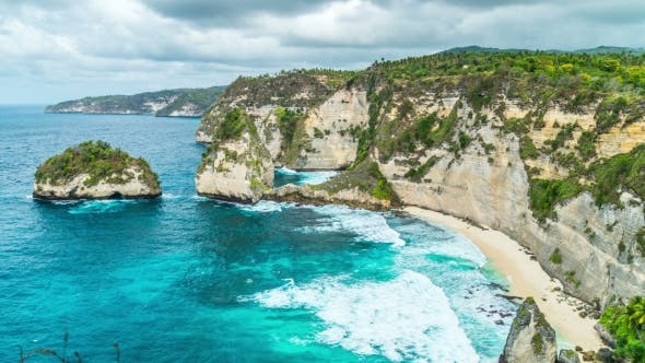 Cover Image for Rocky Coast with Big Waves at Atuh Beach on Nusa Penida Island, Indonesia