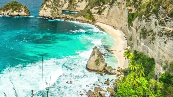 Cover Image for Rock in the Ocean with Beautiful Palms Behind at Atuh Beach on Nusa Penida Island, Indonesia