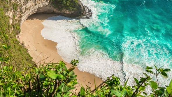 Thumbnail for Ariel  View on Beach with Waves and People at Kelingking Beach on Nusa Penida Island, Bali, Indonesi