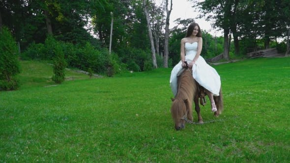Thumbnail for the Girl Is Riding a Pony
