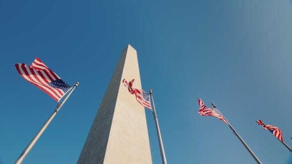 Thumbnail for Washington Monument in DC, USA, American Flags Flap Below